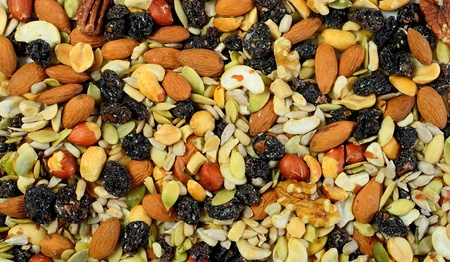 mixed nuts and raisin background.