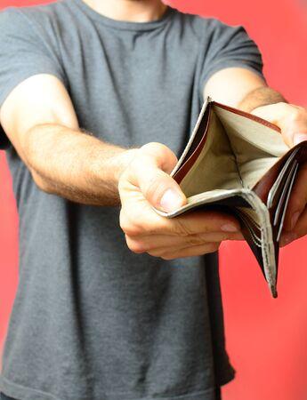 empty wallet: Guy showing empty wallet
