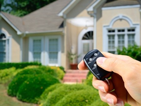 Remote control lock to a home. Stock Photo - 9694258