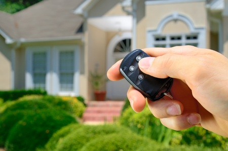 Remote control lock to a home. Stock Photo - 9694266