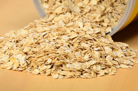 Oatmeal spilling out of bin. Selective focus on middle of pile. Stock Photo - 9694228