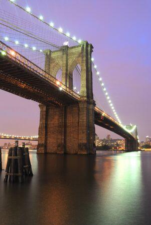 The Brooklyn Bridge shimmering at night. photo