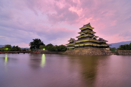 The historic Matsumoto Castle under pink skies, dating from the 15th Century in Matsumoto, Japan. Stock Photo - 10051812