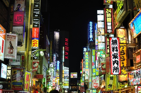 tokyo japan: TOKYO - JULY 4: Kabukicho is the historic red light district of Tokyo and is known for the myriad of lit signs July 4, 2011 in Tokyo, Japan. Editorial