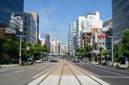 hiroshima: HIROSHIMA, JAPAN - JULY 16: Being located on a delta, Hiroshima opted to keep their tram line in the 1980s while other cities abandoned them for subway systems July 16, 2011 in Hiroshima, Japan. Editorial