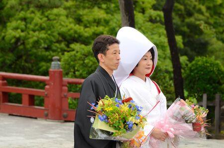 Kamakura, Japan - July 19, 2011: A traditional Japanese wedding ceremony at Tsurugaoka Hachiman-g¨±, the most important temple in Kanagawa Prefecture.