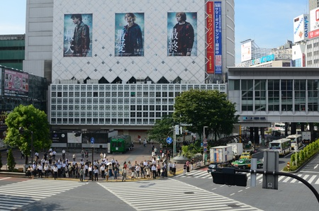 implementations: TOKYO, JAPAN - JULY 6: Shibuya crossing is one of the most well known implementations of a scramble crosswalk in the world on July 6, 2011 in Tokyo, Japan.