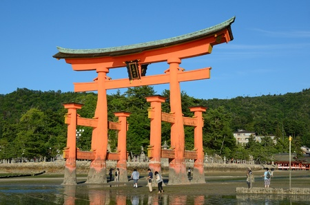 inlet bay: The otori gate which welcomes visitors to Miyajima, Japan at low tide.