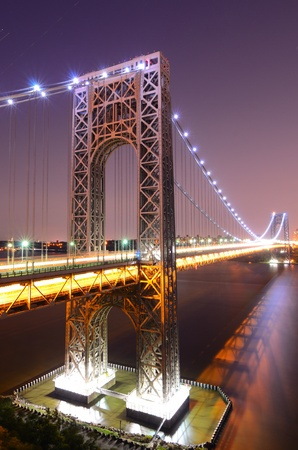 The George Washington Bridge spanning the Hudson River at twilight in New York City. photo