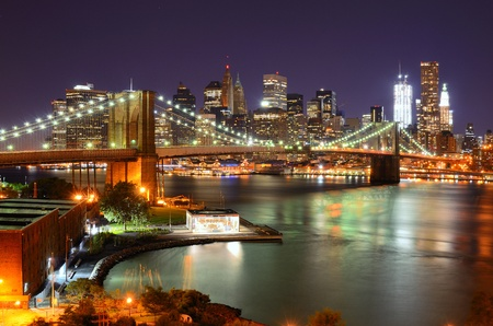dark city: View of Downtown New York City and Brooklyn Bridge