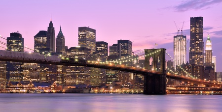 night scenery: Brooklyn Bridge and Lower Manhattan skyline in New York City.