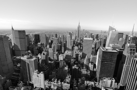 Black and white skyline of Manhattan looking towards downtown with landmark buildings.