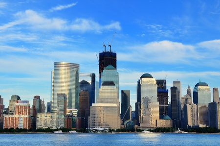 building trade: Downtown Manhattan skyline with World Trade Center Building construction peaking above the city. Stock Photo