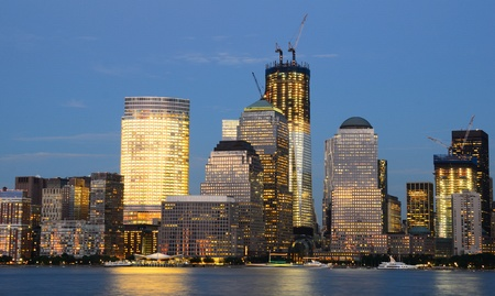 Downtown Manhattan viewed from across the Hudson RIver at night. Stock Photo - 10545787
