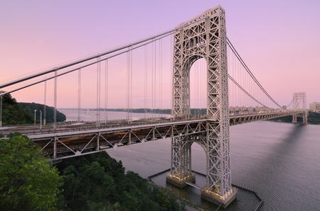 steel arch bridge: The George Washington Bridge spanning the Hudson River at twilight in New York City. Stock Photo
