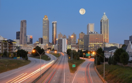 moon  metropolis: Skyline of downtown Atlanta, Georgia from above Freedom Parkway with a full moon. Stock Photo