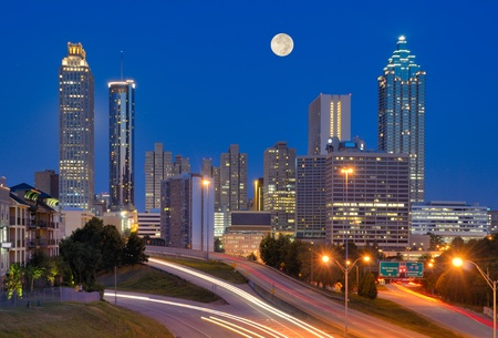 atlanta: Skyline of downtown Atlanta, Georgia from above Freedom Parkway with a full moon. Stock Photo