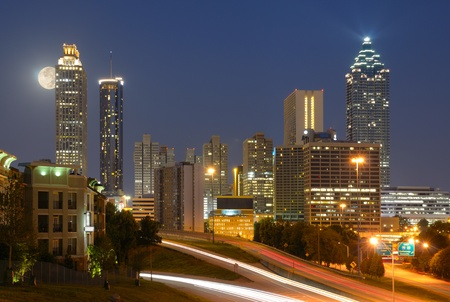 Skyline of downtown Atlanta, Georgia from above Freedom Parkway with a full moon. Stock Photo - 10601801