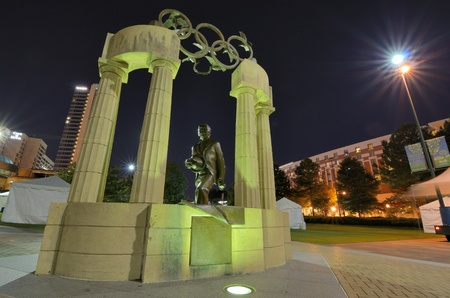 coubertin: ATLANTA - SEPTEMBER 24: Pierre de Coubertin commemorative statue at Centennial Olympic Park September 24, 2011 in Atlanta, GA. Coubertin is considered founder of the modern Olympic games.