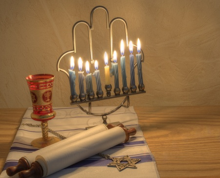 jewish prayer: A Judaic Hannukah Menorah, and other objects.