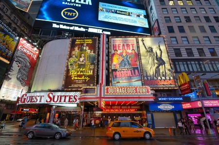 widely: NEW YORK CITY - AUGUST 27, 2011: Billboards for theatrical productions on Broadway August 27, 2011 in New York, NY. Broadway is widely considered to represent the highest level of commercial theater. Editorial