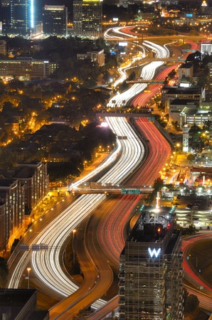 infamous: ATLANTA - SEPTEMBER 24: Interstate 85 winds through downtown September 24, 2011 in Atlanta, GA. Atlanta�s infamous traffic puts the city near the top of most national lists ranking the worst commutes. Editorial
