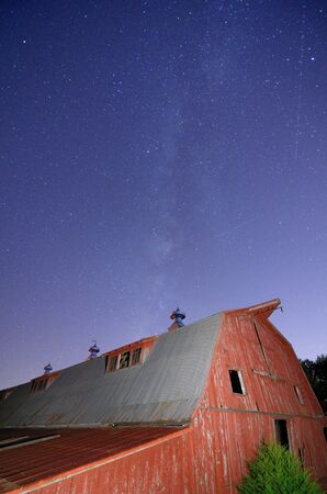 old red barn: Abandoned barn with the milkyway overhead. Stock Photo
