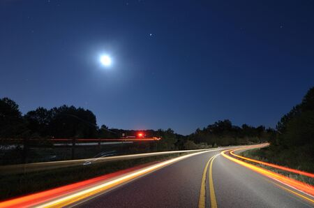 country roads: Cars pass on a country road atnight