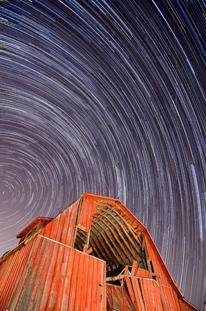 An abaonded barn under star trails Stock Photo - 11021950