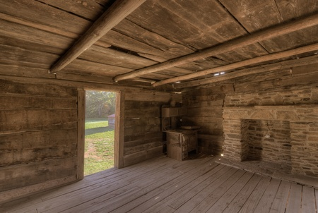log on: interior of an old log cabin Stock Photo