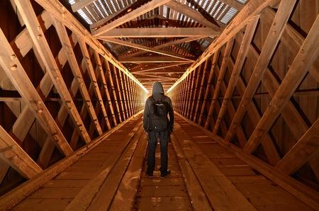 unused: Urban explorer in an unused covered bridge Stock Photo