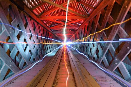 supernatural light inside of a wooden tunnel photo