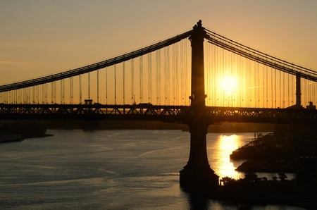 silhoutted: Manhattan Bridge silhoutted against the sunset