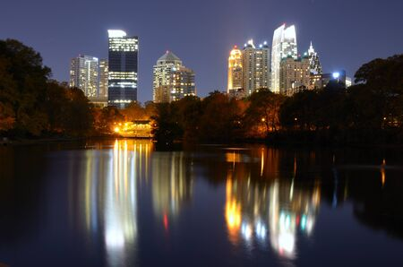 Skyline and reflections of midtown Atlanta, Georgia in Lake Meer from Piedmont Park. photo