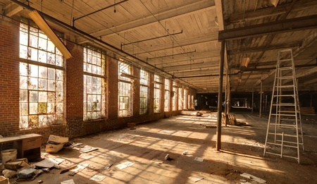 abandoned factory: old gritty abandoned factory interior Editorial