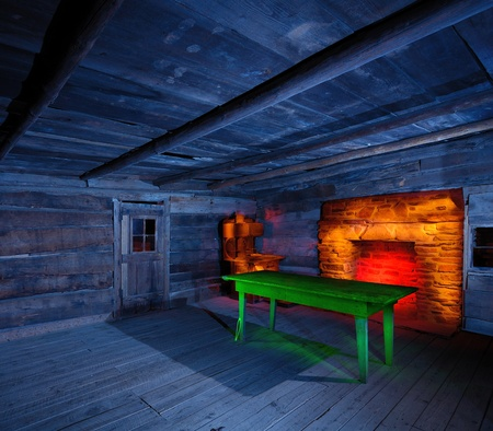 Interior of an historic wooden cabin with light painted furnishings Stock Photo - 11501751