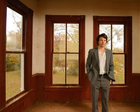 Suited Man in Antique Home photo