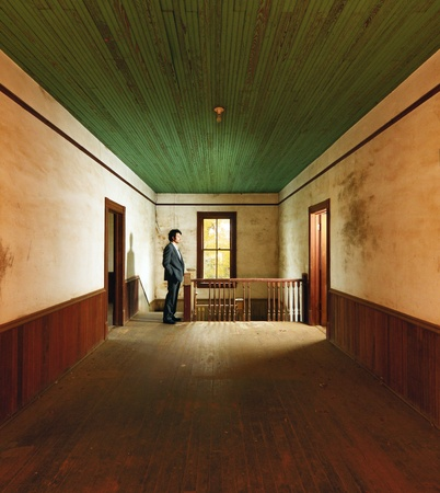 corridors: Suited Man in Antique Home Stock Photo