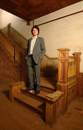 Suited Man on Stairs in Antique Home photo