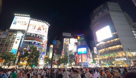 Tokyo, Japan - July 5, 2011: Pedestrians cross at Shibuya crossing.