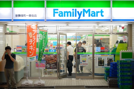 convenience store: Tokyo, Japan - July 5, 2011: Family Mart Convenience store in Shinjuku. Headquartered in Tokyo, it is the 3rd largest convenient store chain in Japan and largest convenient store chain in South Korea.