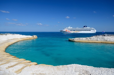 Cruise ship off the coast of a sandy caribbean beach