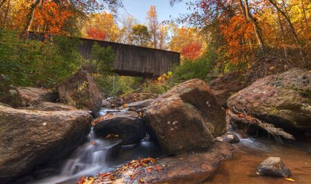 covered bridge': Old Covered Bridge over an Autumn Stream