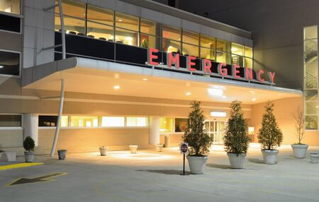 Emergency Room entrance at a hospital at night.
