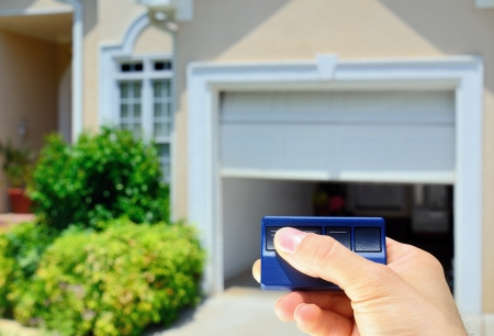 Garage Door Opener opening a residential garage door. Stock Photo - 12200930