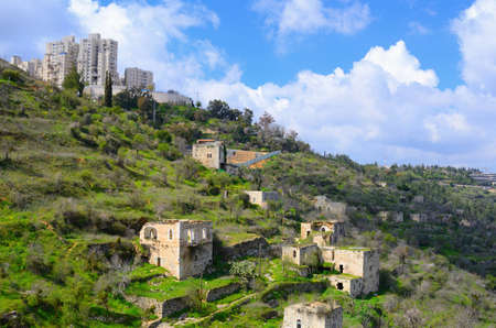israeli: Lifta, a Jerusalem village which was abandoned by the Palestinians during the Israeli War of Independence, juxtaposed against new Israeli high rises