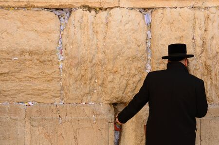 Jerusalem, Israel - February 17, 2012: A hassidic Jew prays at the wailing wall in the Old City. Editorial