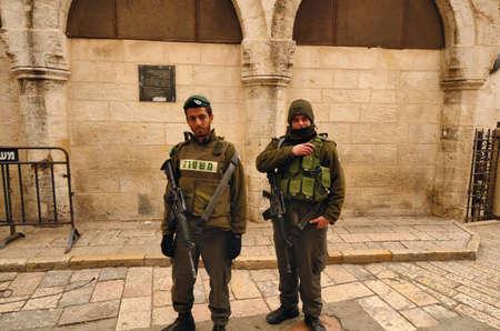 israeli: Jerusalem, Israel - February 17, 2012: Members of the Israeli Defence Force in the old city of Jerusalem.