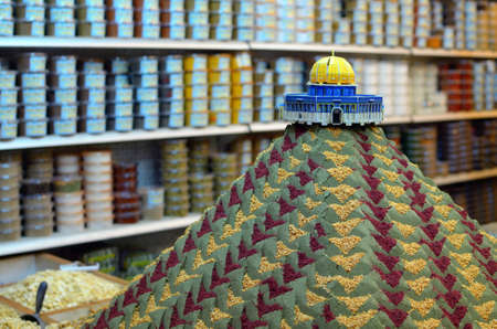 suq: Spice mound with small model of the Dome of the Rock in the Souq of Jerusalem, Israel. Editorial