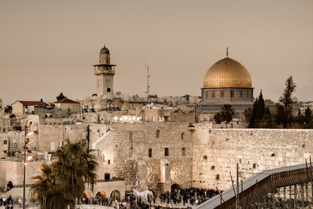 The Western Wall, also known at the Wailing Wall or Kotel, is the remnant of the ancient wall that surrounded the Jewish Temple's courtyard in jerusalem, Israel. Dome of the Rock is a Muslim Shrine located on the Temple Mount. Stock Photo - 12734317